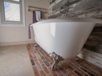 Spa Master Bath with brick and barnwood